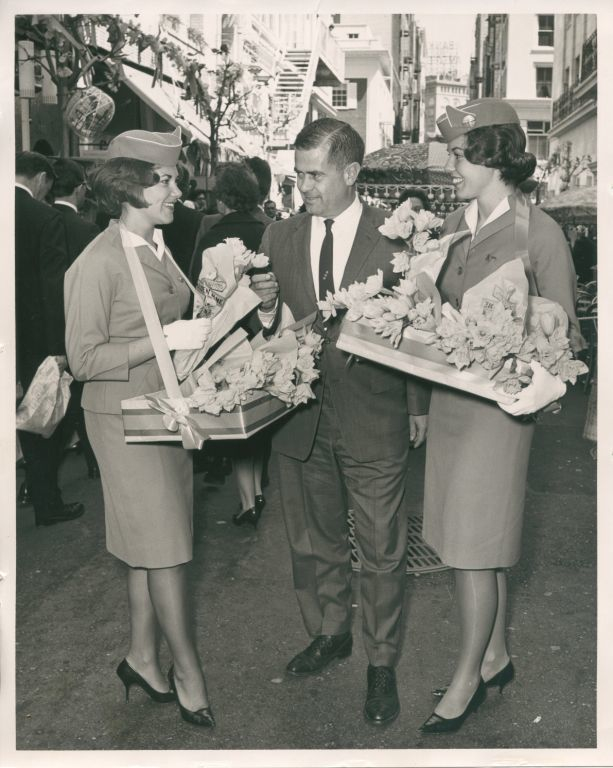 """Spring comes to Maiden Lane"" in San FranciscoBarbara Longnecker (left) and Pat Smith (right) with  the District Sales Manager from the Pan Am sales office on Union Square"